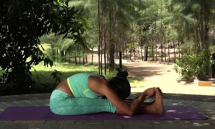 Paschimottanasana (Seated forward bend) steps, precautions and benefits